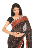 Indain woman in black designed sari Stock Photography