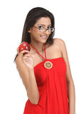 Indan girl with apple and specs Stock Images