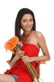Indan  teenage girl sitting with daisy flowers Stock Photo