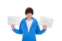 Indecisión - muchacho del adolescente con opciones Foto de archivo libre de regalías