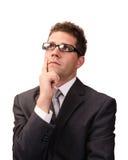 Indecision. Businessman thinking isolated on white background royalty free stock photography