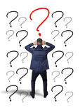 Indecision of a young businessman. On a white background royalty free stock image