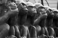 Indecisive Monkeys. Statue - focus on middle monkey Stock Photo
