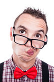 Indecisive nerd face. Closeup of indecisive nerd man face, isolated on white background Stock Photo