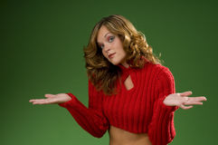 Indecisive woman on Christmas green background Royalty Free Stock Image