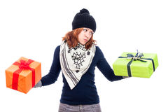 Indecisive woman holding gifts Stock Images