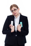 Indecisive woman with pills Stock Photo