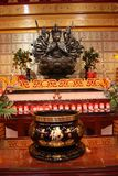 An indefinite sacred religious statue of a Chinese Buddhist temple. Bright colors and orange background stock image