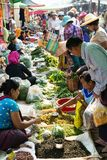 Indein, Myanmar - March 2019: Burmese people shopping on street market. Indein, Myanmar - March 2019: Burmese people shopping on street farmer market, local royalty free stock photos