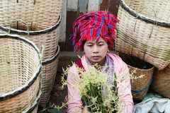 Indein, Myanmar - March 2019: Burmese woman sells bamboo baskets on the street market. Indein, Myanmar - March 2019: Burmese woman from Pao dragon tribe sells stock image