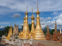 Shwe Indein Pagoda. Indein is one of the small villages of Inle Lake located on the western bank of the lake. A Buddha image has enshrined at a whitewashed stupa Royalty Free Stock Image