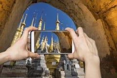 Indein Village Smartphone Photography. Tourist taking pagodas photo with smartphone in Indein village, Myanmar Stock Photos