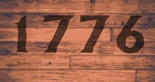 1776 Independence Day Brand. Date Independence Day branded onto wooden planks Stock Images