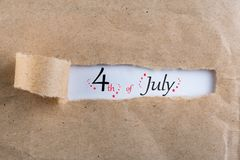 Independence Day Celebration. July 4th. Image of july 4 calendar at brown torn envelope background. Summer day Royalty Free Stock Images