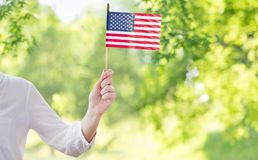 Close up of woman holding american flag in hand royalty free stock images