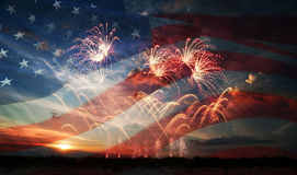 Independence day. Celebratory fireworks on the background of the US flag and sunrise. Independence day Stock Photos