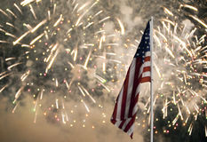 Independence Day Fireworks. With the US Flag in the foreground stock image