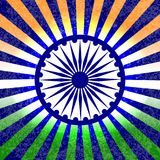 Independence Day of India. 15 August. Rays from the center. The colors of the flag are green, white, saffron. Blue wheel with 24 s. Pokes. Grunge background Stock Photos