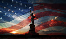 Independence day. Liberty enlightening the world. Statue of Liberty on the background of flag usa and sunrise Royalty Free Stock Photography