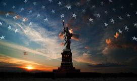 Independence day. Liberty enlightening the world. Statue of Liberty on the background of flag usa and sunrise Stock Image