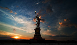 Independence day. Liberty enlightening the world. Statue of Liberty on the background of sunrise and cloudy sky Royalty Free Stock Images
