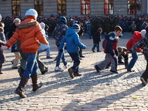 Independence Day, Lublin, Poland. Celebrations of the Independence Day, Lublin, Poland, 11th November, 2011. Children collecting bullet cases after an honorary stock photography
