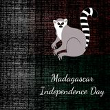 Independence Day in Madagascar. 26 June. Flag of Madagascar, lemur, grunge dark texture. Independence Day in Madagascar. 26 June. Concept of a national holiday Royalty Free Stock Photography