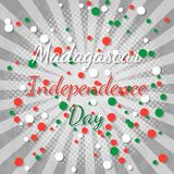 Independence Day in Madagascar. 26 June. Rays from the center. Gray background, grunge texture. Circles of flag colors - white, re. Independence Day in Stock Photo