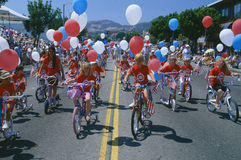 Independence Day Parade. Children riding bicycles in Independence Day Parade Stock Photography