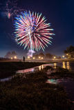 Independence Day in Prattville. Prattville, Alabama, USA - July 4, 2017: Independence Day fireworks display as seen from Autauga Creek in Prattville Stock Photography