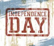 Independence day stamp on wooden background Royalty Free Stock Photography
