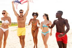 Happy friends with american flag on summer beach royalty free stock image