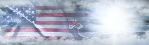 Independence Day, 4th of July. American Flag In The Sky. Surrounded By Clouds And Sun Rays Stock Photo