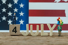 Independence day USA with miniature people old man holding ballo Stock Photos