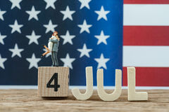 Independence day USA with miniature people young couple standing Stock Photography