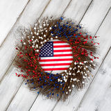 Independence Day wreath with flag on rustic white wooden boards Stock Photography