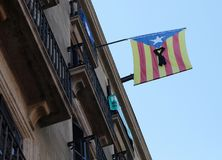 Independence flag with black ribbon in central barcelona. An estelada, catalonia pro independence flag, with a black ribbon in central barcelona Stock Image