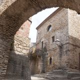 Independence flag, estelada, behind an arch made of stone in Per. Atallada, Spain Royalty Free Stock Photos