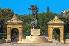 Malta - Views of Floriana. Bronze and marble Independence Monument by Ganni Bonnici at the entrance to the Maglio Gardens - Floriana, Malta Stock Photos