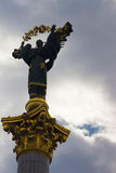 Independence monument in Kiev, Ukraine. This is a statue of an angel, made of copper, and gold plated, standing on a tall pillar, Royalty Free Stock Photo