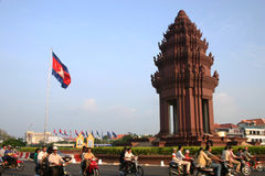 Independence Monument, Phnom Penh, Cambodia. Cambodian flag flying at the Independence Monument Stock Photography