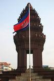 Independence Monument, Phnom Penh, Cambodia. Cambodian flag flying at the Independence Monument Stock Images