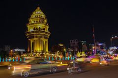 The Independence Monument in Phnom Penh, Cambodia, at night. The Independence Monument in Phnom Penh, Cambodia, with traffic at night Royalty Free Stock Photo