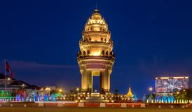 Independence Monument in Phnom Penh. The Cambodian Independence Monument and Phnom Penh skyline at night Stock Image