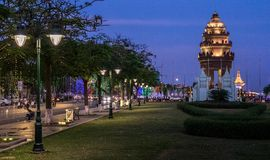 Independence Monument in Phnom Penh. The Cambodian Independence Monument and Phnom Penh skyline at night Stock Images
