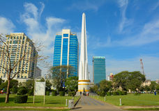Independence Monument in Yangon. YANGON, MYANMAR - JAN 15, 2015. Burmese people visit at Independence Monument in Mahabandoola park in downtown Yangon (Rangoon Royalty Free Stock Photos