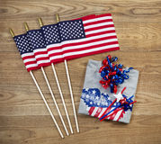 Independence Objects for holiday in United States of America. Overhead view of United States of America flags, ribbons, t-shirt and pinwheels positioned on Stock Photography