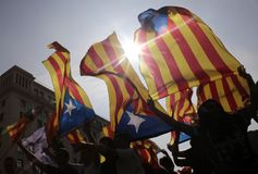 Independence referendum in barcelona backlight. Demonstrators carry estelada flags, catalonia pro separatist flag, during a protest the day after the banned pro Royalty Free Stock Photos