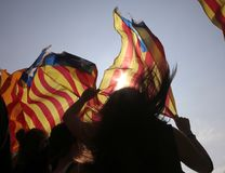 Independence referendum supporters in barcelona backlight. Demonstrators carry estelada flags, catalonia pro separatist flag, during a protest the day after the Royalty Free Stock Photo