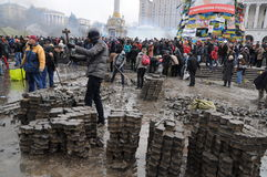 Independence Square Kiev. Revolution in Kiev Ukraine showing the population breaking up paving stones as weapons in Independence Square royalty free stock photography